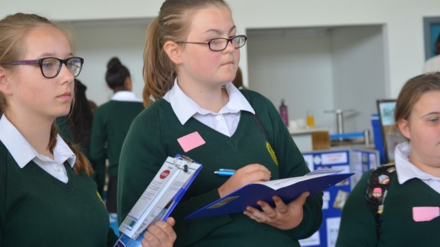 Pupils taking notes while speaking with our Neoperl exhibitors