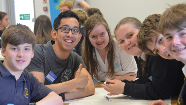 One of the University or Worcester's student Mentor's Eric, working with pupils at the skills for tomorrow food workshop.