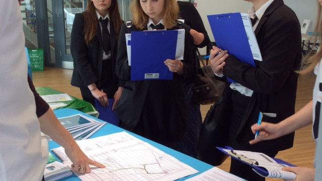 Harrison Clark Rickerbys staff discussing legal issues of solar PV farms with RGS pupils